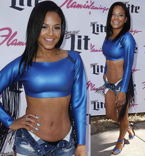 Christina Milian Bares Stomach in Cropped Fringe Swimsuit and Daisy Dukes As She Hosts GO Pool