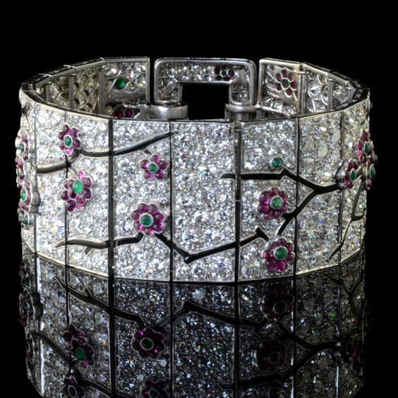 CARTIER. Art Deco c1925. Beautiful diamond, sapphire, emerald and ruby Blossom design bracelet with touches of black enamel.