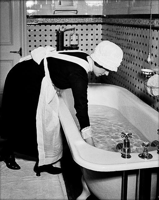 Photo of a parlour maid preparing a bath in 1939 - many Devon women entered domestic service in London.