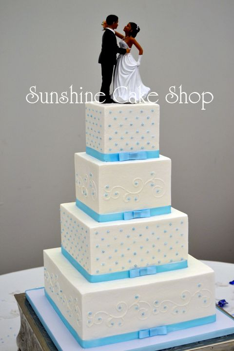 """4"""", 6"""", 8"""", 11"""" square cakes (serves 118)Buttercream covered cakes with Swiss Dots and stenciled swirls. Coordinated ribbons and sugar pearls add some classic style."""