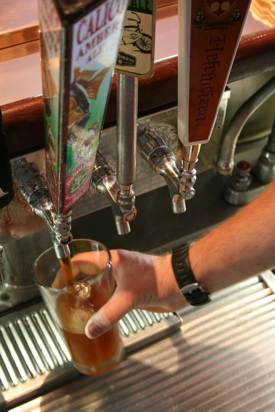 Pouring crisp delicious California Craft Beers at Moray's Lounge on Mission Bay at the Catamaran Resort Hotel and Spa