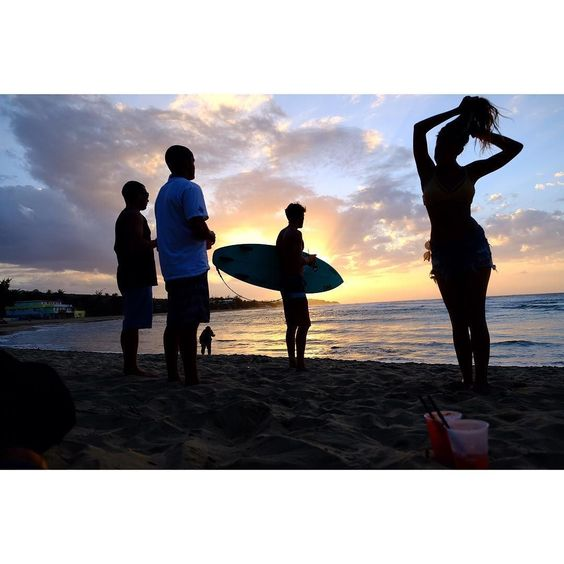 Trying to decide if they are gonna paddle out one more time. If the surf was fantastic no decision. Surf in the dark. Yet when it's good but not great maybe another rum punch works best at sunset on Jobos beach Puerto Rico. April 2016. I continue with my work on BeachGames #Jobos #puertorico #surfers by davidalanharvey