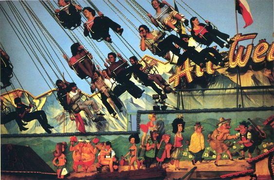 ® Ernst Haas. A photo of a fairground ride and people going on it. The thing I like about this photo is that the swings are not blurry.