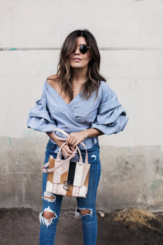 21 Genius Summer 2016 Outfit Ideas to Steal: A Shoppable Guide | 'Style MBA' blogger wearing a ruched sleeve wrap blouse with distressed denim: