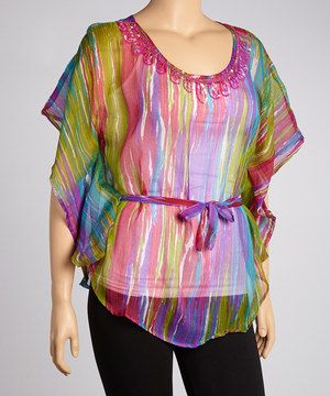Top off an ensemble in colorful style! This streaked tunic boasts a vivid look and a loose-fitting silhouette to skim curves for maximum figure flattering.