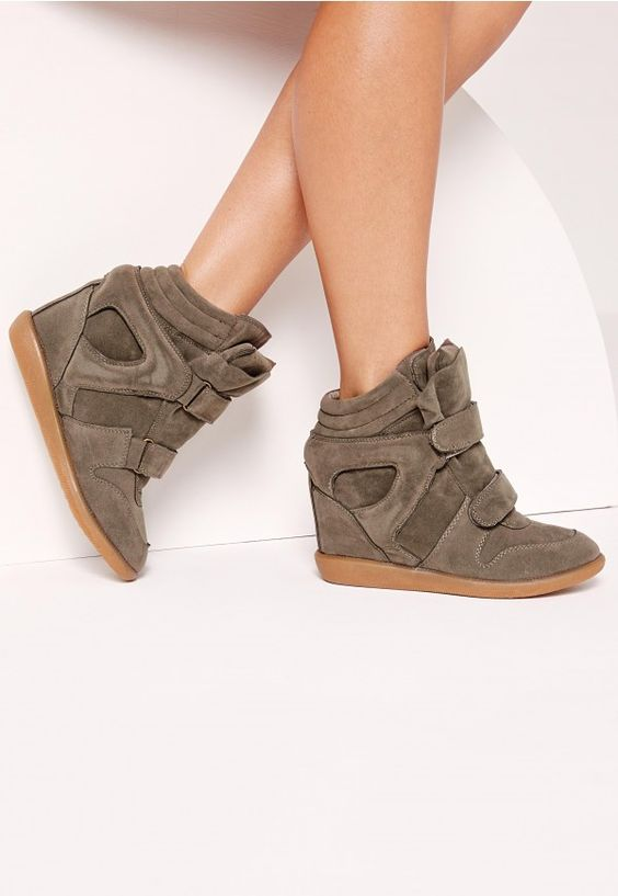 Rock the sports luxe trend in style and score some new treads in these wedge high top trainers. These faux suede beauts will instantly update your shoe-drobe and have you looking super fly. Wear with leather joggers and a crop top for smart...