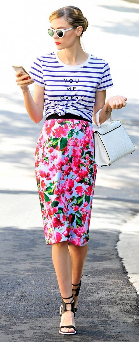 MIX YOUR PRINTS Combining colors, scale, and patterns in a way that looks dynamic takes practice, but there are some basic tricks to getting it right. You can wear two prints that repeat the same colors or mix a large-scale pattern with a smaller one. What's even easier is to use the second motif as an accent.