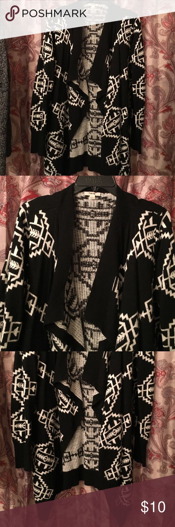 Aztec open cardigan. Size L. Aztec open cardigan. Size L. Worn slightly in under arm area. Other than that, great shape. Nice shrug for fall. Timing Sweaters Cardigans