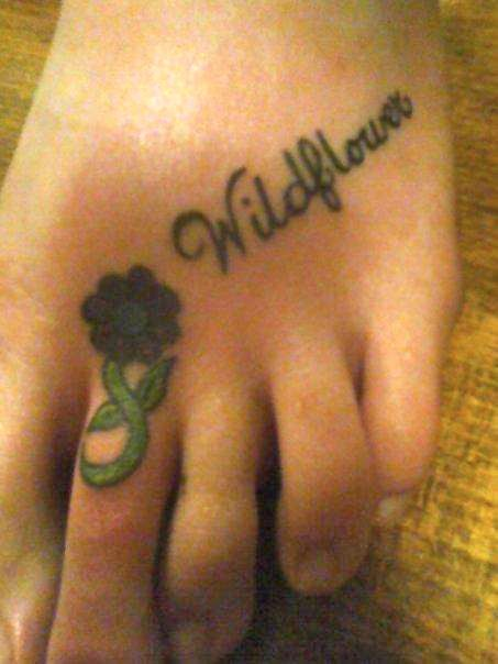 I love the girl scouts and Wildflower is my camp name. This tattoo comes with a song!!  Theres a daisy on my toe, It is not real, it does not grow, Its just a tattoo of a flower, so i look neat taking a shower. Its on the 2nd toe of my left foot, A stem and flower but theres no root, because that wouldnt look good!! Purty daisy on my toe, my right foot loves my left foot so!!  *MUAH*