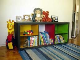I like the colors inside the bookshelf-bright and vibrant!  Thinking about doing this when I repaint shelf for Ethan