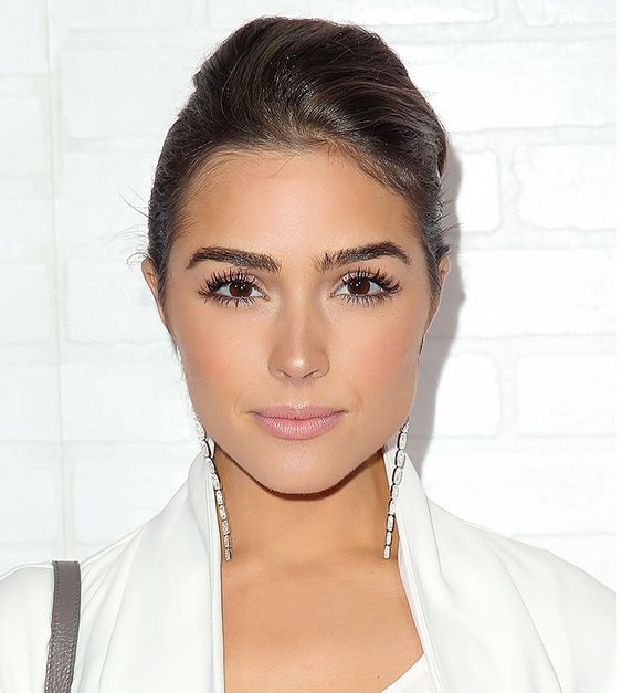Olivia Culpo with simple makeup and thick, beautiful brows