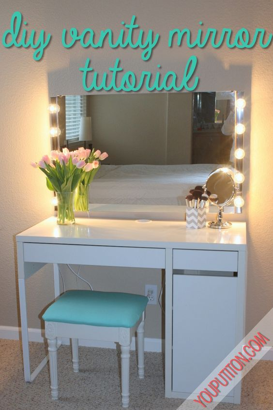 Prop up $5 walmart mirror with lamps around, paint a cheap desk white, get a little stool, put power strip up and have plenty of room for everything in a little corner! Maybe string xmas lights up around.