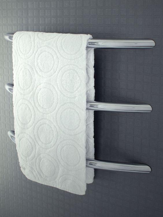 Kado cirque wall mounted heated towel rail reece for Bathroom designs reece
