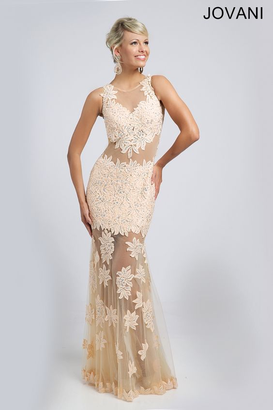 Sleeveless Mermaid Dress Breathtaking sleeveless mermaid dress features a sheer neckline and skirt embellished with appliques