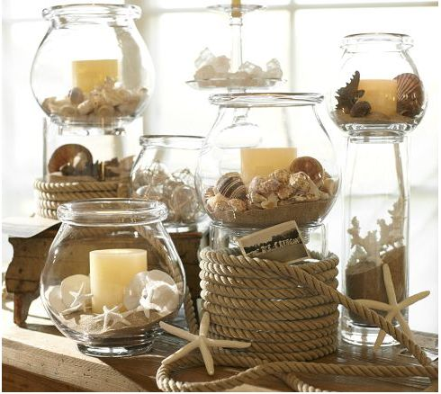 Candles, rope, shells, glassware.  All great things that come together to create a beautiful centerpiece for a beach themed wedding reception.:
