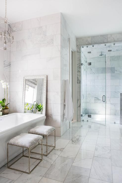 Staggered Polished Marble Floor Tiles In A Transitional Bathroom Feature A Timeless Surface For A Marble Tile Floor White Marble Bathrooms Marble Tile Bathroom