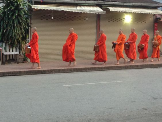 idea for 'Progress Dawn' by Gulf States - band in orange robes (pref in harvest brown field, not on street). blob of colour on their heads. maybe street shot for internal cover.