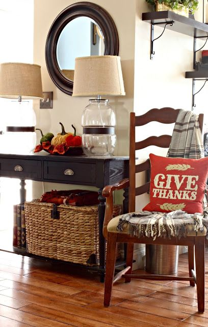 Fall decor in family room with velvet pumpkins, plaid Ikea throw and basket chest-www.goldenboysandme.com: