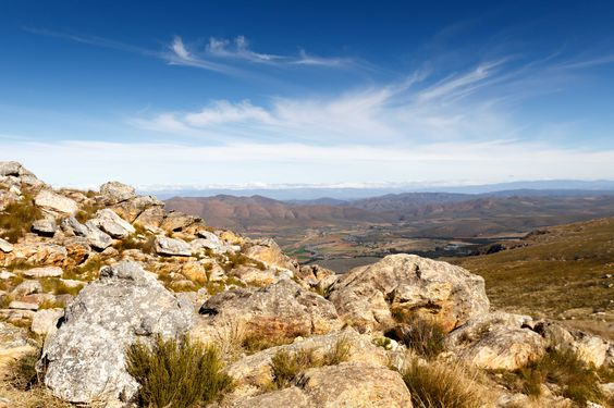 Mountain with farm lands and clouds - The Swartberg Pass Mountain with farm lands and clouds - The Swartberg Pass on the R328 run through the Swartberg mountain range.