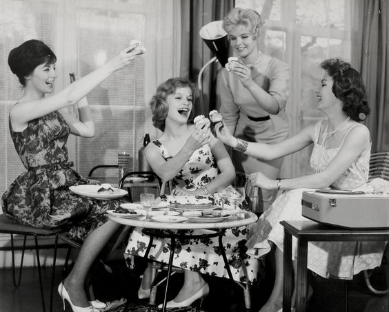 1950s vintage black and white photograph of girls afternoon tea party.