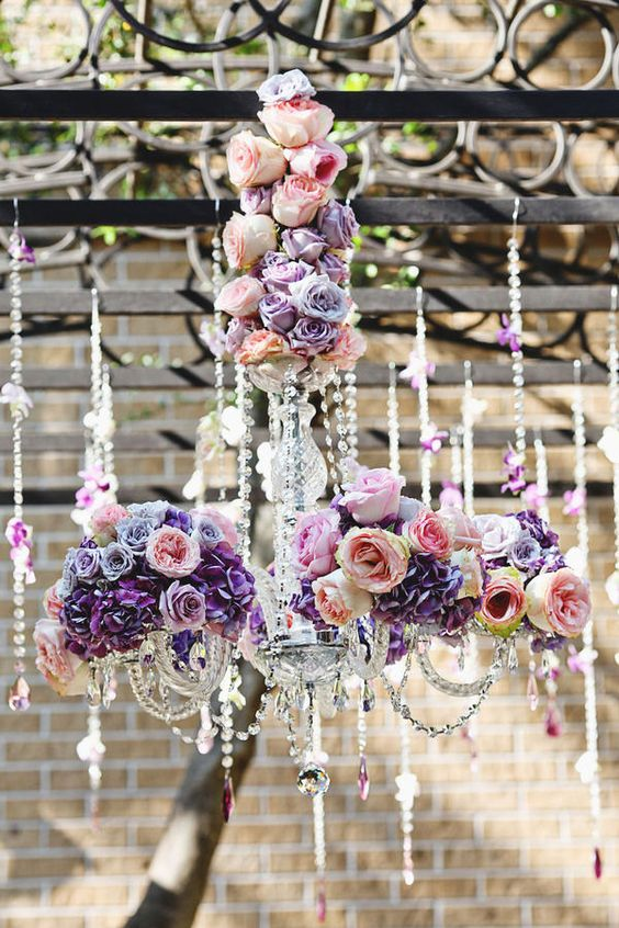Gawjiss flower-bedecked chandelier hanging over the table instead of a centre-piece!