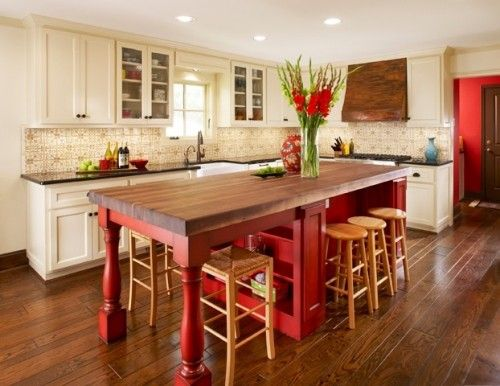 red island with white cabinets