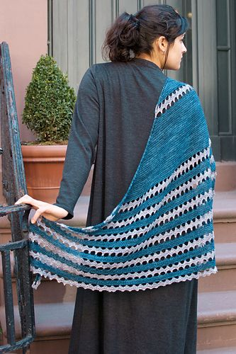 """This two-color asymmetrical, curved triangle shawl begins at one narrow end and increases to the border. Broad bands of garter stitch are separated by graphic rippling sections that remind me of a rambling path. The name was inspired while visiting my sister in England. We were walking in the charming village of Etton, not far from her home, and our """"ramble"""" made me think of the new shawl design that was currently on my needles. We decided then and there that this shawl would be named Ramble…"""