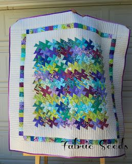 Fabric Seeds: li'l twister quilt.  It's so cute with the postage stamps of the fabric in the twisters.  Great idea for finishing.