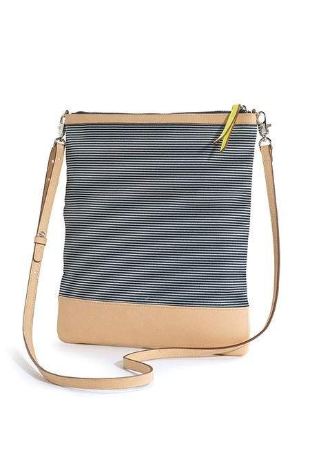Striped Skinny Waverly Petite | Stella & Dot  Striped Skinny Waverly Petite | Stella & Dot  Versatile crossbody bag for an everyday casual look. Easily converts from full length crossbody, to fold over crossbody, to a fold over clutch. Signature hardware with shiny silver nickel finish, citron zipper pull, and citron and nude ikat print lining.  Use the link in my profile to shop!  www.stelladot.com/sarahtaliaferro: