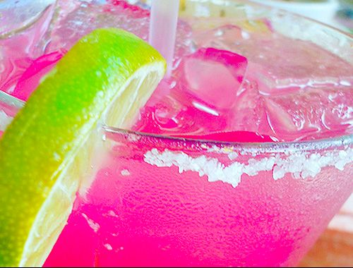Pretty Pink Drink - Cranberry Juice, Pineapple Juice, OJ, Sprite. Shake all ingredients except Sprite.  Pour in glass top with sprite. Garnish with lime to set off pink color.