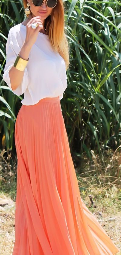 Pair a coral maxi skirt with a loose white top and you have yourself a cute and comfy spring and summer outfit.