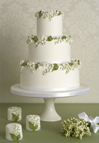 Perfect for a spring wedding. This fresh and contemporary cake features intricately hand crafted sprays of lily of the valley sugar blossoms and leaves accentuated with a touch of lustre tumbling over the edges. Created by Peggy Porschen.