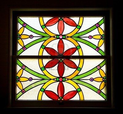 Stained Glass Window of Stylized Red and Yellow Flowers Stock Photo