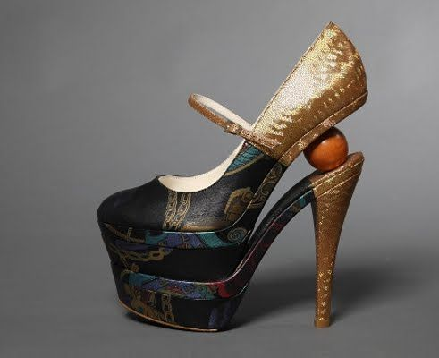 Split sole; CHECK.   Concealed platform; CHECK.  Gold 6+ inch heel; CHECK.  Ball in the heel; EH? WHAT?
