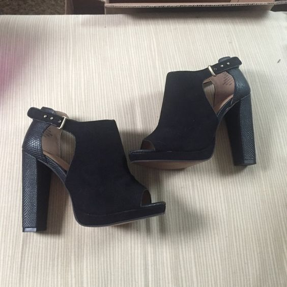 Never worn black bootie heels Never worn leather snake skin and suede black bootie heels. Size 5.5 can fit 6 Shoes Heels
