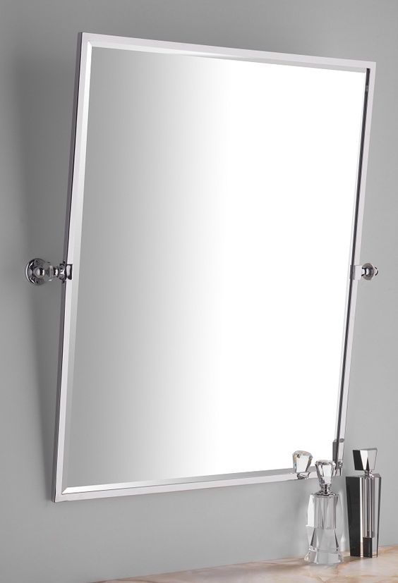 Bathroom Mirrors Quality porcelain_door_knobs a rectangular tilting bathroom mirror of the