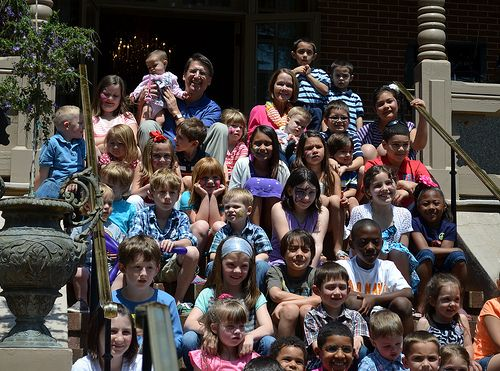 RALEIGH, N.C. - North Carolina Governor, Pat McCrory and his wife, First Lady, Ann McCrory (holding children at the top) take a picture with military children from all of the military services across the state during their Month of the Military Child Celebration here, April 27. The N.C. First Lady hosted the event with support from 4-H Club of N.C., USO of N.C., Kangaroo Express and the N.C. National Guard's Family Programs office.