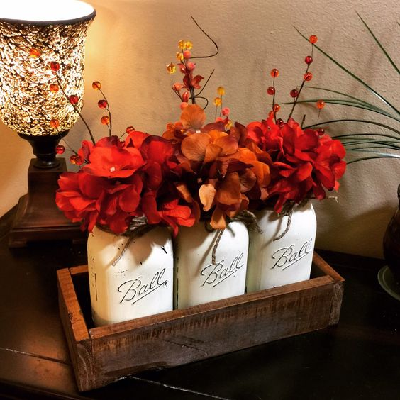 Home and Living, Mason Jar Decor, Fall Decor, Fall Decorations, Wedding Centerpiece, Floral Centerpiece, Painted Mason Jars, Fall Home Decor by GBTButtonsNBows on Etsy https://www.etsy.com/listing/243422661/home-and-living-mason-jar-decor-fall: