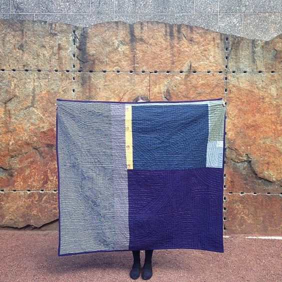 "Artist Heidi Parkes with her quilt, ""Night and Day,"" in front of a sculpture by Ulrich Ruckriem at The Art Institute of Chicago sculpture garden.  Even the stone looks quilted!  #Handquilted #quilt"