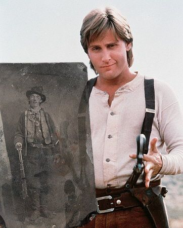 YOUNG GUNS (1985) - Emilio Estevez (who portrays 'Billy the Kid') poses with the only known photo of the New Mexico outlaw - Directed by Christopher Cain - 20th Century-Fox - Publicity Still.