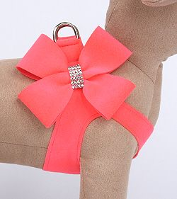Electric Pink Nouveau Bow Pure & Simple Puppy Dog Step-In Harnesses by Susan Lanci Susan Lanci Ultrasuede Nouveau Bow Dog Step In Harnesses are a timeless addition to any collection! This Nouveau Bow Step in Harness is show stopper, even your pup is bound to know they are pampered! Made only for teacup and toy breeds. Our Nouveau Bow Collection gives you the best of style and plenty of bling. The Bow is handcrafted giving it an attention grabbing 3-dimensional quality. Additionally,