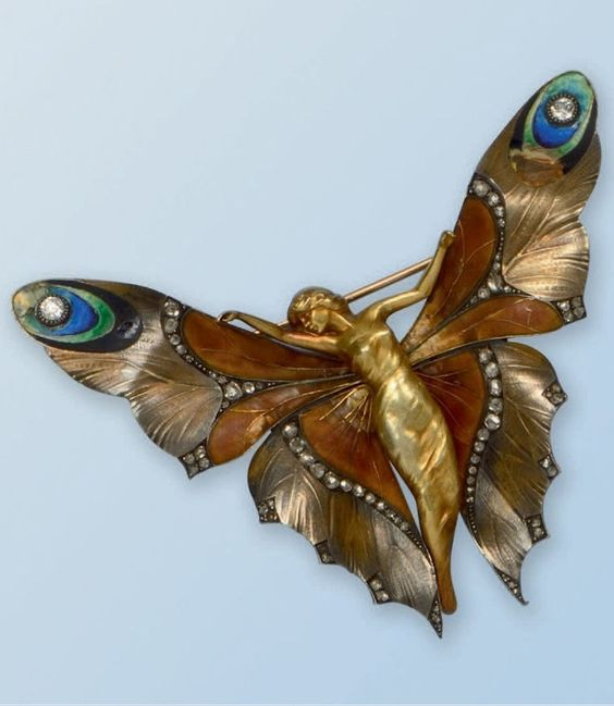 An Art Nouveau gold, enamel and diamond brooch, by Lucien Gaillard, French, 1900s. Designed as a butterfly woman with outstretched wings, partially enamelled and highlighted with rose-cut diamonds. Signed GL and numbered. 7.8 x 6.7cm. #LucienGaillard #ArtNouveau #brooch: