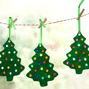 Christmas tree ornaments. You just need a cookie cutter, felt, plastic beads, and glue.
