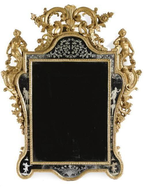 An Italian carved giltwood mirror, Venetian, circa 1735: