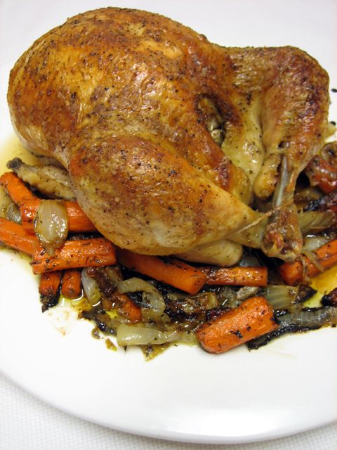 Roasted Whole Chicken with Vegetables - I am giving this a shot tonight with brussel sprouts, onions, potatoes and carrots: