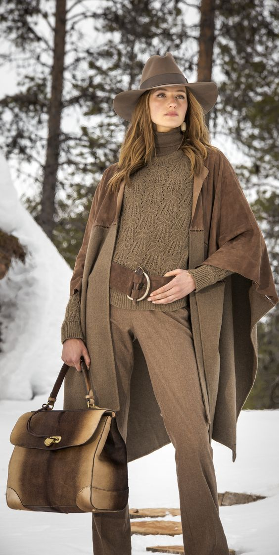 Ralph Lauren Fall 2015: A suede top panel and a cashmere-and-wool-blend bottom panel, linked by intricate silk stitches, give the Fillmore cape a rustic elegance. Drape the open-front design over a sweater-and-pant look for luxe flair.
