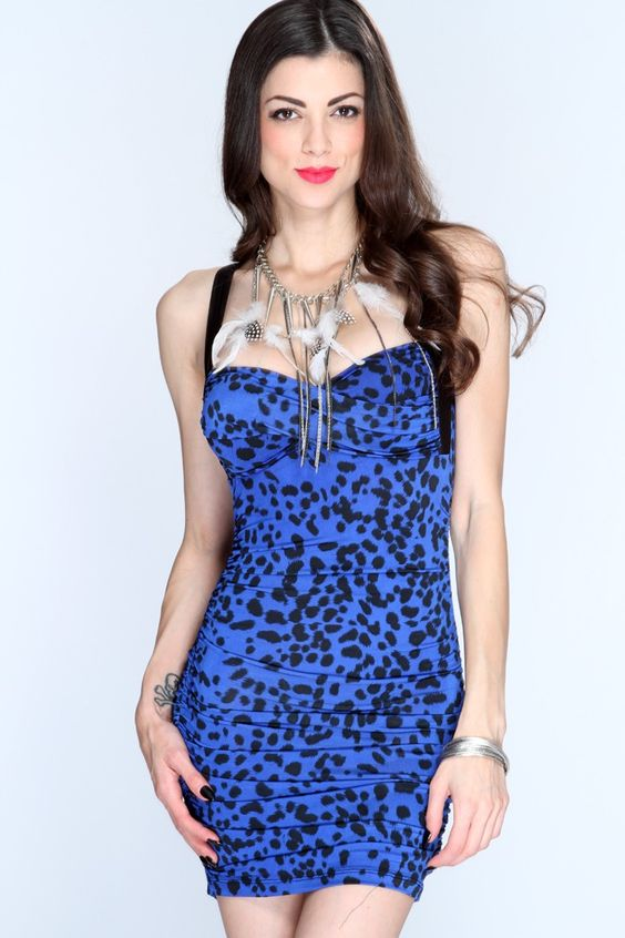 Go out and strut your stuff in this sexy fierce dress! You sure wont be missed when you step out in this one of a kind dress! Youll love it the moment you try it on! Definitely a must have for your wardrobe collection! It features animal print, sweetheart neckline, light padded, twisted center, ruched, sides, cross strap back, and tight fitted. 96% Polyester 4% Spandex.