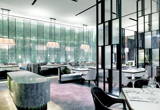 The dining room at French Window shimmers with frosted-glass panels. Hong Kong.