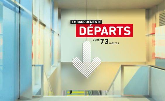 Panneau signalétique dans le hall de l'aéroport Lyon - Agence Grapheine
