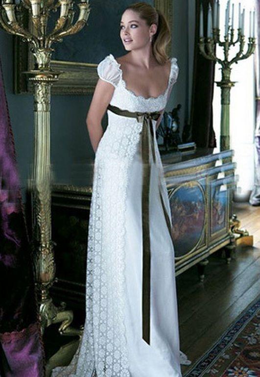 Vestido de novia - VN65 - Realizado en satén 395. Con encaje y breteles de organza. Lazo desmontable de saten 395 incluido. Corsetado